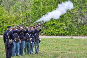 A  Civil War re-enactment group fires a salute in Hanson. Photo by Stephanie Spyropoulos.